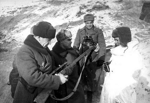 General Vassily Chuikov inspects sniper Vassili Zaitsev's rifle