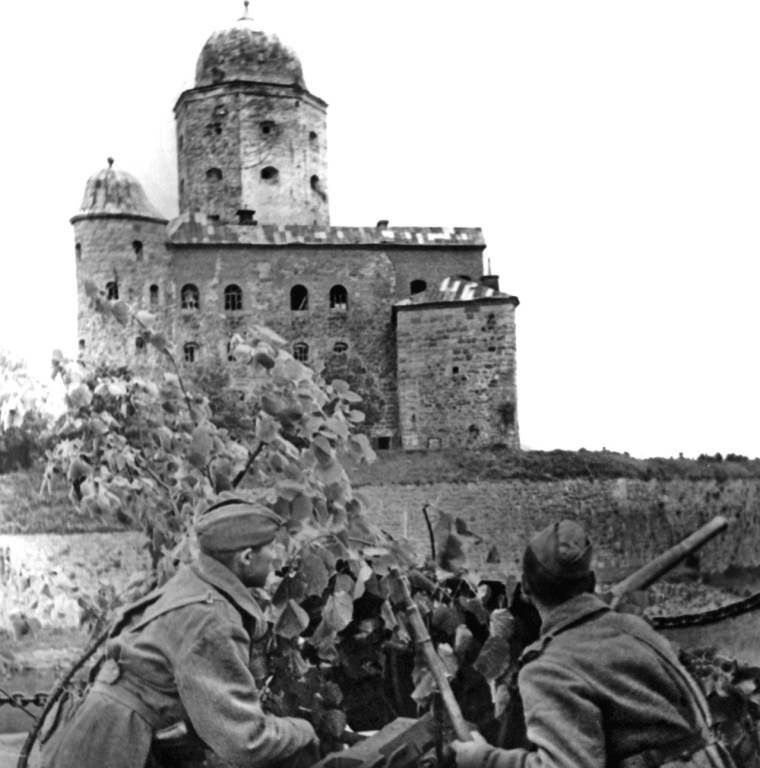 Soviet soldiers manning a 45 mm anti-tank gun in front of Vyborg Castle, June 1944.