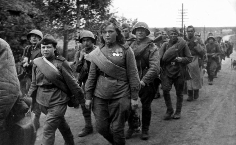 Soviet soldiers of the Leningrad Front march to the frontlines during the lengthy Siege of Leningrad.