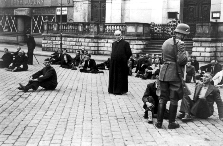 Polish civilians, including a Catholic priest, are held as hostages awaiting execution by Wehrmacht soldiers following Bloody Sunday