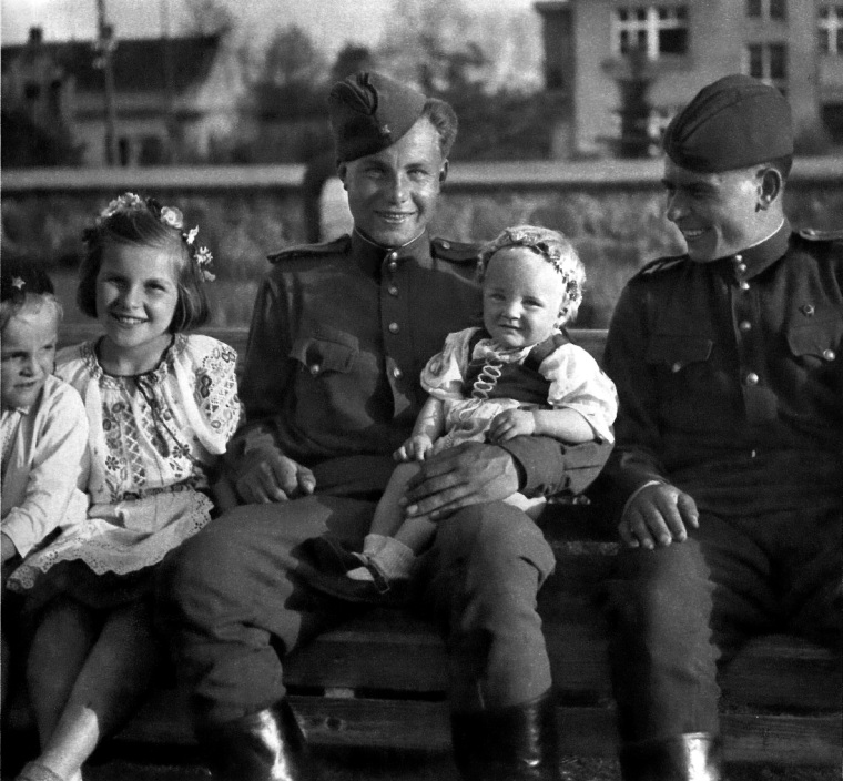 Soviet soldiers of the 3rd Shock Army pose for a photograph with Czech children..